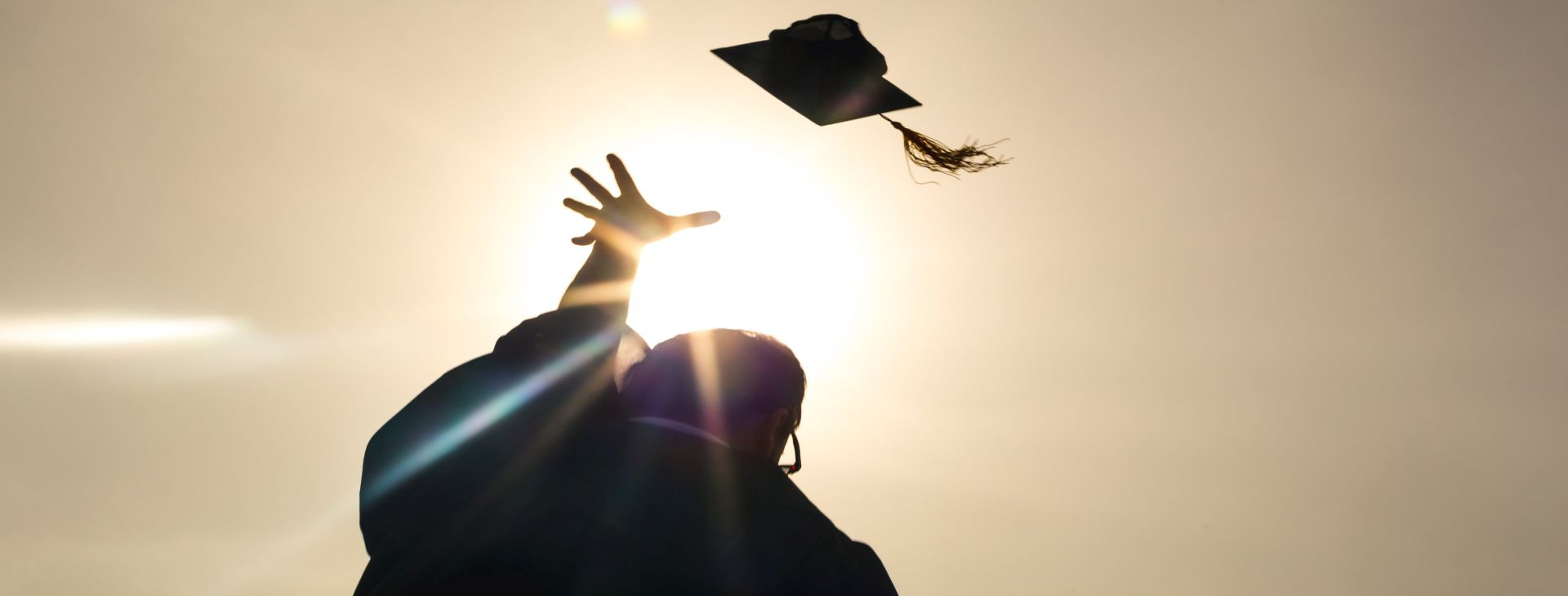 grad-student-throwing-up-cap